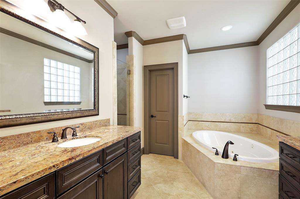 Luxurious master bath with dual vanities, jetted tub and large shower.