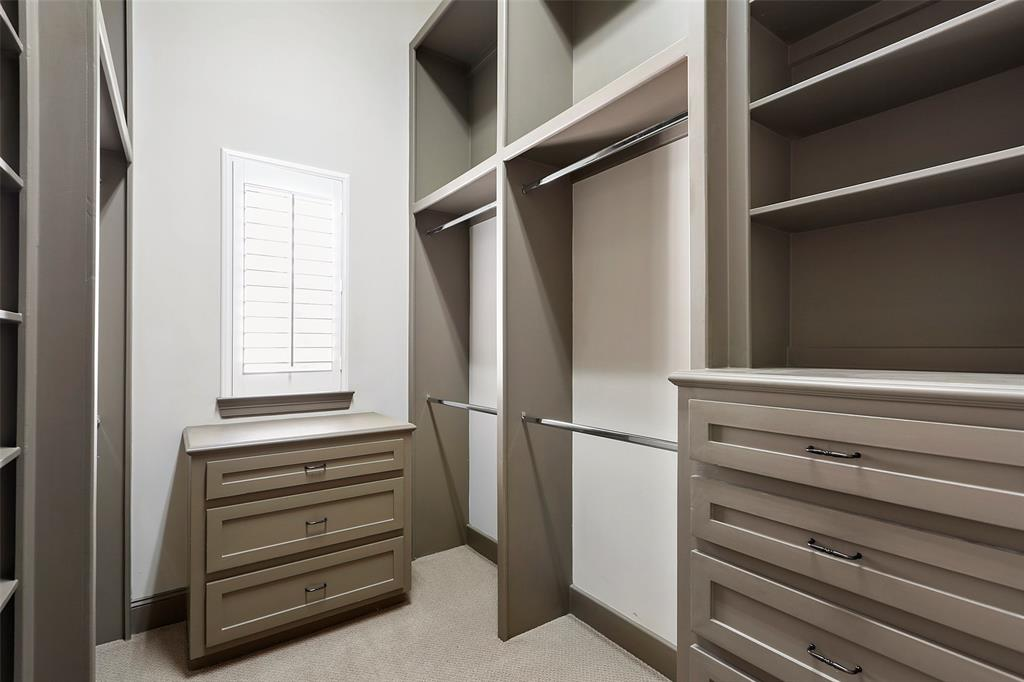 Walk-in closet in the master suite with built-ins.
