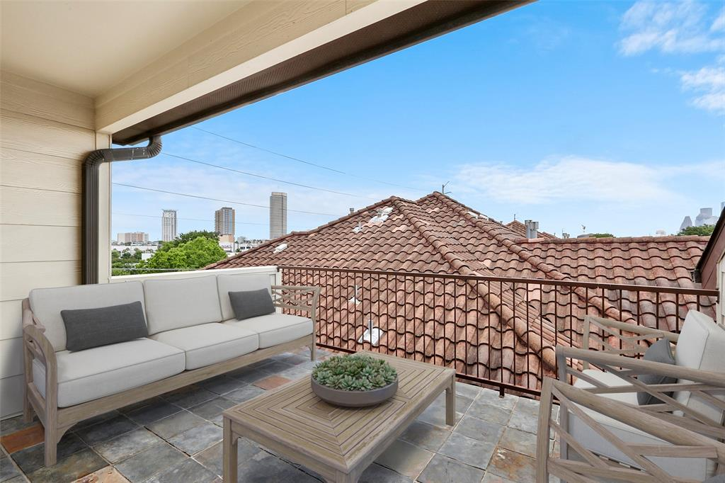 The roof-top deck is another outdoor space to use for entertaining or relaxing with your family. This photo has been virtually staged.