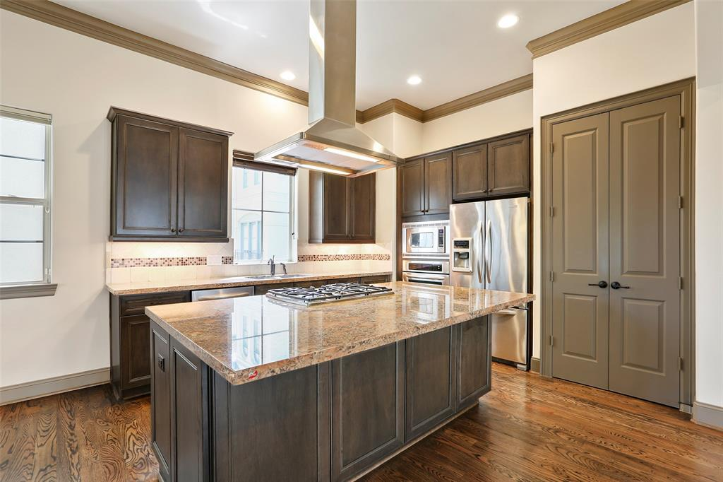 The center-island kitchen features granite counter tops, stainless-steel appliances and lots of storage