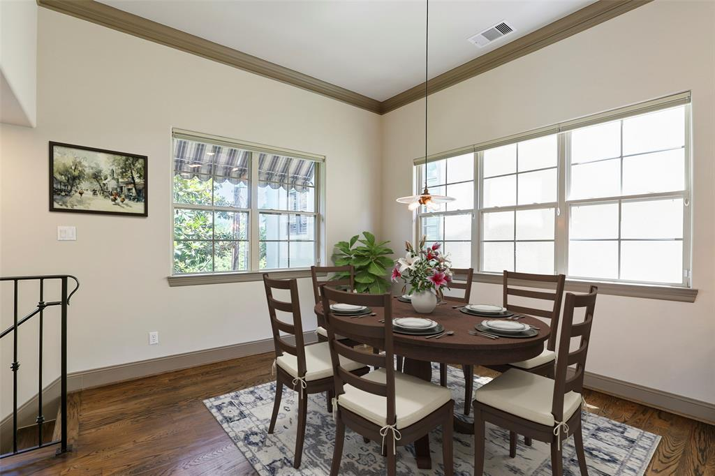 The dining space adjacent to the kitchen is large enough to fit a six or eight person dining table. This photo has been virtually staged.
