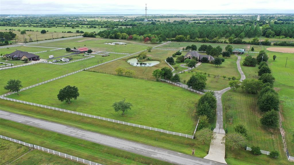 Beautiful property located on 10.173 +/- acres in the gated Hunter Creek Estates.Complete w/Barnmaster barn, 2 stalls w/paddocks & extended overhangs,center aisle breezeway, 12x12 tack room w/window & 12x12 hay storage rm.Custom 13'x36' loafing shed built to match by Sutherlands of Brenham. 2 roll-up doors custom made for 2 of the stalls, which is used for tractor & implement storage,3rd made into an equine stall, w/custom sliding doors.Stunning 590 sq. ft. salt water pool w/gunite finish,Pentair equipment,gas heater, & Paramount in-floor cleaning syst.Spa features 6 jets on 2 levels.Spacious house features a library/study w/a wall of shelves to display your books, & formal dining rm.Living area has double sided f/p, custom built-ins & is open to the kitchen.Lrg island kit w/granite counters,plenty of custom cabinetry for storage & ample counter space to prepare meals.Master with f/p. Game rm up w/fabulous wine rm.Huge bonus/exercise rm.Screened-in porch w/f/p that overlooks the pool.