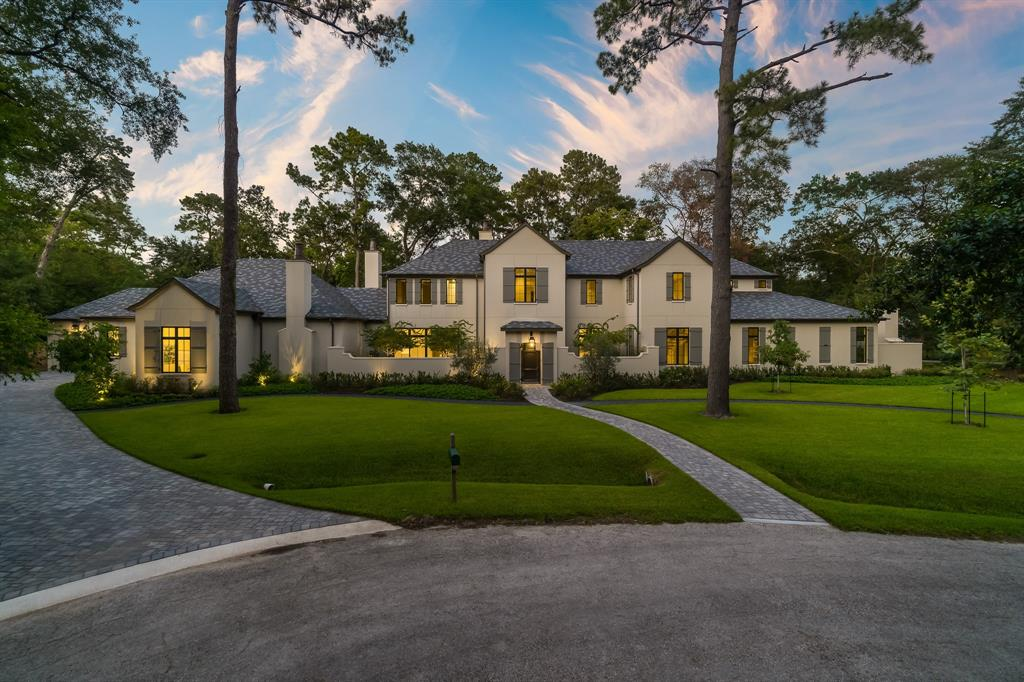 This stunning Hunters Creek estate sits on nearly an acre of lush landscaping. Well appointed custom finishes throughout. Formal living greats you upon entrance with grand hallway connected to the family, kitchen and the Master's retreat. Ideal for entertaining, Luxury Kitchen with professional grade appliances, full butlers kitchen, well equipped butlers bar attached to formal Dining Room with temper controlled Wine Room. High ceiling throughout the home are complemented by the rounded ceilings in the Family Room. Master suite features an en suite office/ flex room, outdoor retreat with fireplace and luxurious en suite bath. Owners bath features dual closets with adjoining locking closets, dual washrooms, steam shower, and coffee bar. The home is complete with optional bedroom or downstairs study with en suite bath. Featuring upstairs game room, up and down utility rooms, 4 Guest Suites with full en suite baths, elevator installed.