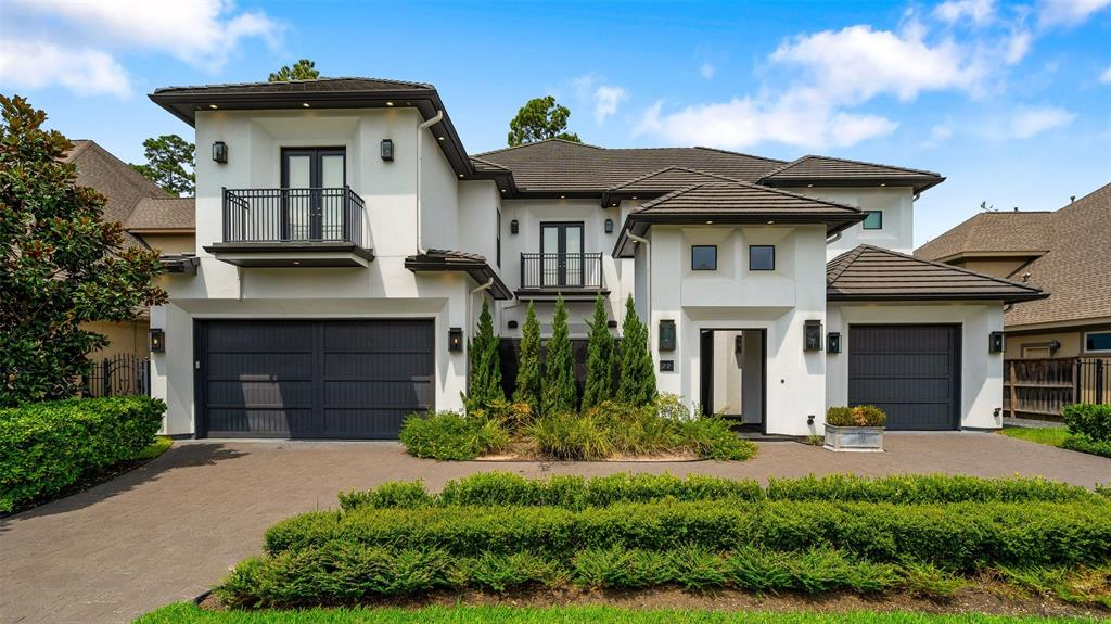 Stunningly updated Modern home with high ceilings, wall of windows and lots of designer updates you will love.