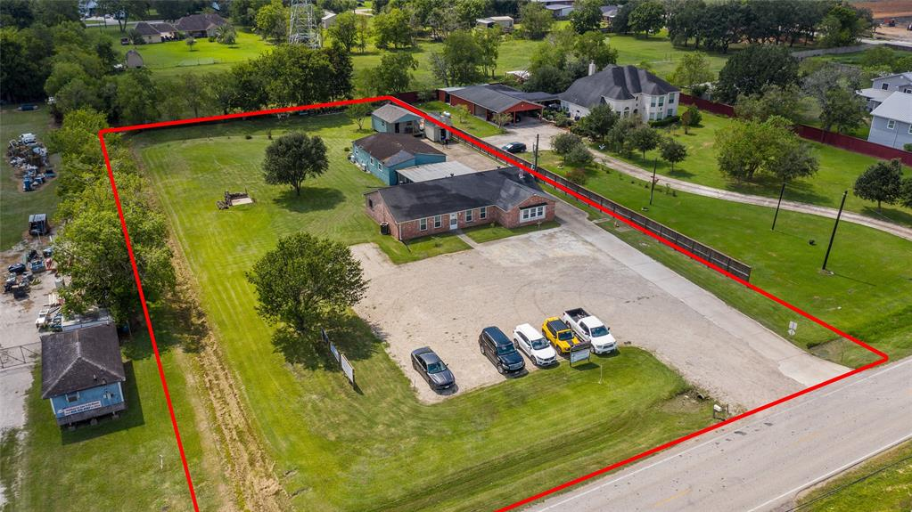 Opportunity is knocking! Out of City limits & no restrictions. Work, Live & Play at one great location! This mix-use property is perfect for someone who is looking to operate a business, live in the back home & have plenty of room to roam. Situated on 1.2 acres. Currently the main building is being used as a Pilates Studio, Massage therapy, Dietitian & private workout facility which is a total of 2,205 sq.ft. Large parking lot for clients. Total of 6 rooms and 2 bathrooms. Huge covered patio between the main building & the second building. The second quarters is approx. 3 years old and offers 1,200 sq.ft. 1 bedroom, 1 bath, beautifully designed kitchen w/custom built cabinetry, dining room, family room & large master bedroom.3 Ductless air conditioning systems which is more efficient & means it can cool your home faster. This home is a delight to walk into & screams welcome home. 20 x 20 building in back could be finished out and potentially become an investment opportunity. Low taxes!