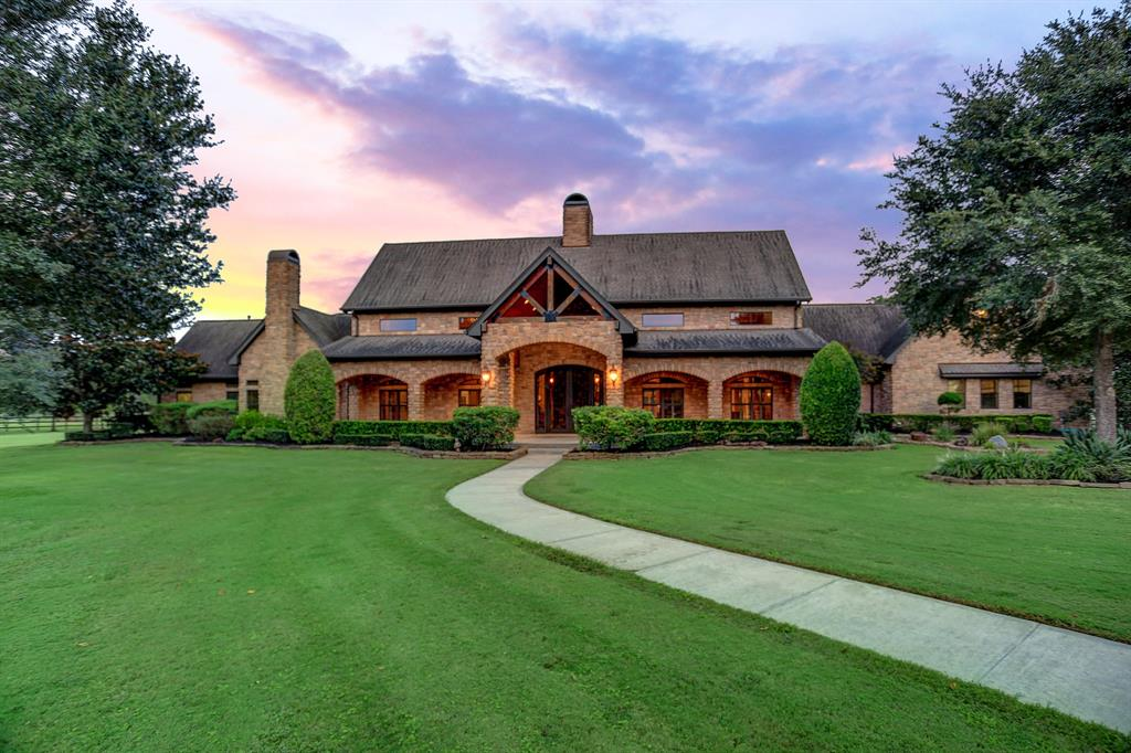 This amazing custom built Texas Hill Country Style Estate is in an upscale Equestrian community spared no expense. From its 30 foot ceilings with timber trusses and beams, 4 stacked stone fireplaces, hardwood floors, spacious rooms, over-sized kitchen with huge island, custom cabinetry, granite counters, stainless steel appliances, and tons of storage. The spacious master with attached sitting room, or gym, or bonus space, en-suite master bath with double sinks, granite counters, huge master shower, separate soaking tub oasis, travertine flooring, and two walk in closets. Two additional bedrooms, with en-suite baths. The resort like outdoor spaces has a pool, great spaces for entertaining. A 60x100 barn that can be created into stables for horses, or used to showcase a car collection. There is also 1700 sqft office space on its own a/c with bath. Private a/c car storage and car lift. And on a 5.9 acres fully fenced and majority on sprinkler system lot. DID NOT FLOOD.