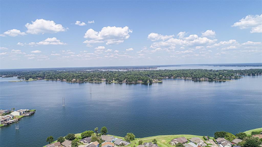 This is a great opportunity to live by the LAKE in prestigious April Sound! This community has everything you want! It is in a great LOCATION close to everything! You are near Conroe, The Woodlands, Montgomery, Magnolia, etc and it has 24/7 manned security. Inside the gates you have all the lake amenities you would expect with golf, tennis, pools, club house, workout room, parks, boat launch, marina, and more! This 1 story condo is updated and has a nice green belt behind your screened in deck which offers great views and a pleasant place to enjoy the evening. You are just a short walk to LAKE CONROE to enjoy the views and throw a line in the water! This condo is updated with granite, nice laminate flooring, new light fixtures, and new appliances that can stay. At this price, it's hard to find a more affordable way to live near the lake or enjoy it on the weekends. Come get it quick!