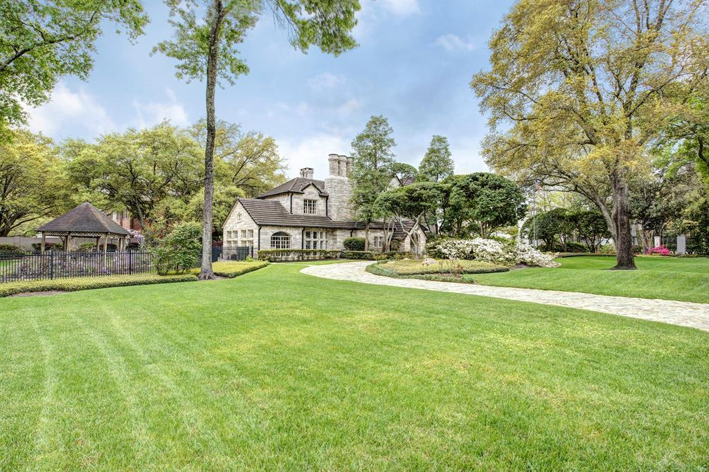 This idillic stone residence, completed in the late 1930s/ early 1940s (per owner),is an incredible opportunity to be in River Oaks on a 37,000 sqft (HCAD) corner lot. Nestled in the prestigious subdivision of Tall Timbers in the heart of River Oaks, the home has been luxuriously updated by the sellers over the course of three major restorations that preserved its period character, added square footage, and introduced modern design, systems, and conveniences. Built by noted River Oaks builder J. Leon Osborn for his family, this two-owner home offers a light-filled floor plan with seamlessly-transitioning formal and informal spaces; restored and reproduced plaster walls and moldings; marble baseboards; hardwood and honed travertine floors; restored, delicately-wrought leaded glass windows and interior doors; open gathering kitchen with breakfast room, bar, and adjoining den overlooking the pool; sumptuous master with fireplace, two full baths with a dressing area.All per Seller