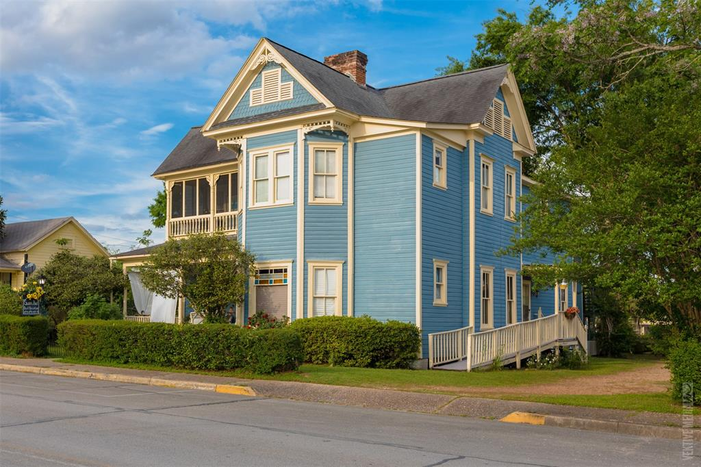 If Historic Charm tops your list of must haves then look no further.  This Impressive Victorian beauty built in 1901 is nothing short of a show stopper with over 6,000 sqft of space!  Currently operating as the Swann Hotel B&B, this historic home leaves the imaginative entrepreneur with an endless array of possibility.  Property situated on Downtown corner lot at .689 Acres with an additional 1058 sqft festivals and scenic Sandy Creek Park in the heart of Texas' butterfly capital; with Lake Sam Rayburn along with National Parks at your fingertips, adventures are at every turn.  This home could be used as a Personal Residence, or continue operating as a bed and breakfast, the opportunities are truly endless!!