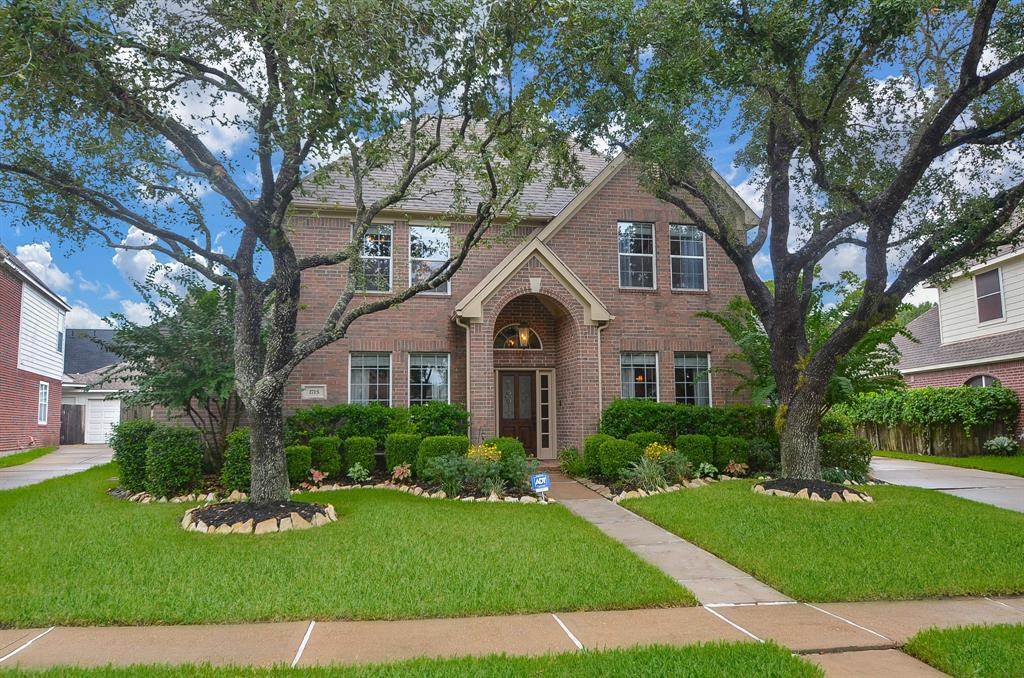 Beautiful 4/3.5 home on a cul-de-sac. Gorgeous backyard with stunning pool & spa. Upgrades galore!!!    Playset stays. Real wood floors, granite. Tree lined quiet street zoned to top schools. Washer,dryer & refrigerator stay.