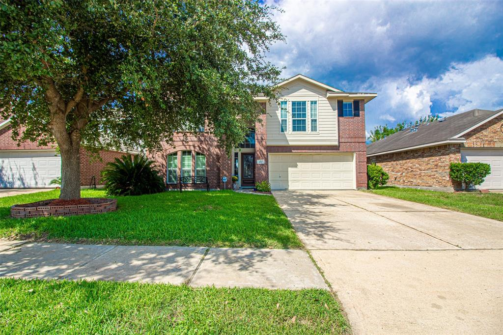 WOW! This is a well maintained home with LOTS of space! It also has a GREAT location so close to I-45 for commuting and right across the street from the park with a green belt behind you for extra space and privacy! You'll love the floor plan on this home because it is nice and open. The kitchen is open to the living with HIGH ceilings and a centered fireplace to enjoy. This is a great floor plan for entertaining or big family gatherings. The kitchen is spacious and truly the heart of the home. There is also a formal dining room for special occasions. Upstairs is another large area to entertain and enjoy family gatherings. There is a large game room that overlooks the living room and is a great space to play games or visit or enjoy a movie. There are 3 bedrooms upstairs making this a great home for family and the park across the street is very convenient. This home is also HIGH AND DRY! It is NOT IN FLOOD ZONE and HAS NOT FLOODED EVER! This is a great opportunity...come get it!