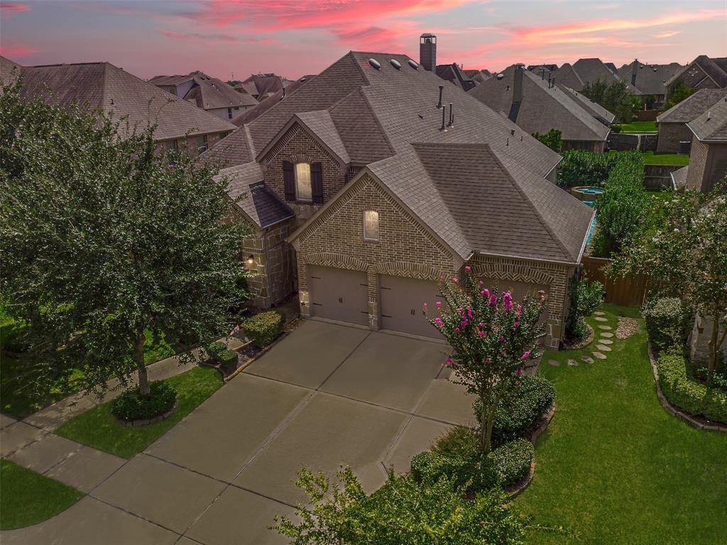 Welcome home to 17415 Hanoverian Dr! This beautiful 1-story Highland home sits at 2,891 sq ft and boasts 4 bedrooms, 3 bathrooms, a STUDY, a 4-CAR TANDEM GARAGE, and a sparkling POOL with a SPA! This amazing home is located on a spacious 8,725 sq ft lot in the incredible master-planned community of ALIANA, featuring a resort-style amenity center with a pool, tennis courts, walking trails, and is zoned to Fort Bend ISD! You'll love all the incredible features this home has to offer, including a spacious study with french doors and crown molding, a gorgeous kitchen with granite countertops and stainless steel appliances, an incredible open floor plan, and a backyard paradise featuring a POOL with a SPA, a spacious covered patio with ceiling fans, custom privacy landscaping, and so much more! Check out the video tour and schedule your private showing of this amazing home today!