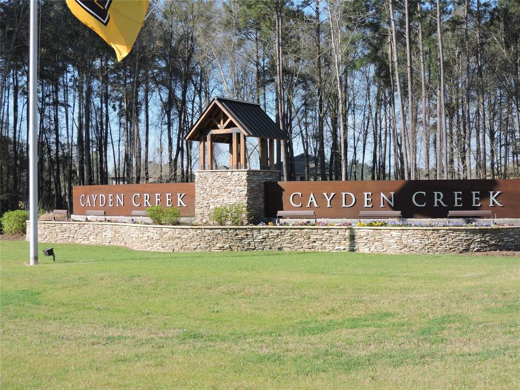 Come Home to the relaxed living at Cayden Creek in Conroe. Enjoy a convenient commute to the Woodlands and downtown Houston with easy access to I-45, Hardy and Hwy 99. Community is close to Lake Conroe, Conroe YMCA, Shopping and Medical. This home built new in 2018 features 5 bedrooms, 3.5 Baths with open living to kitchen design. Granite counters, stainless appliances including refrigerator with gas cook-top. Large master suite downstairs, this home also features a junior suite or second master upstairs, tile and carpet flooring throughout home, private covered patio and large fenced backyard. Acclaimed Conroe ISD Schools. Ready for your family!