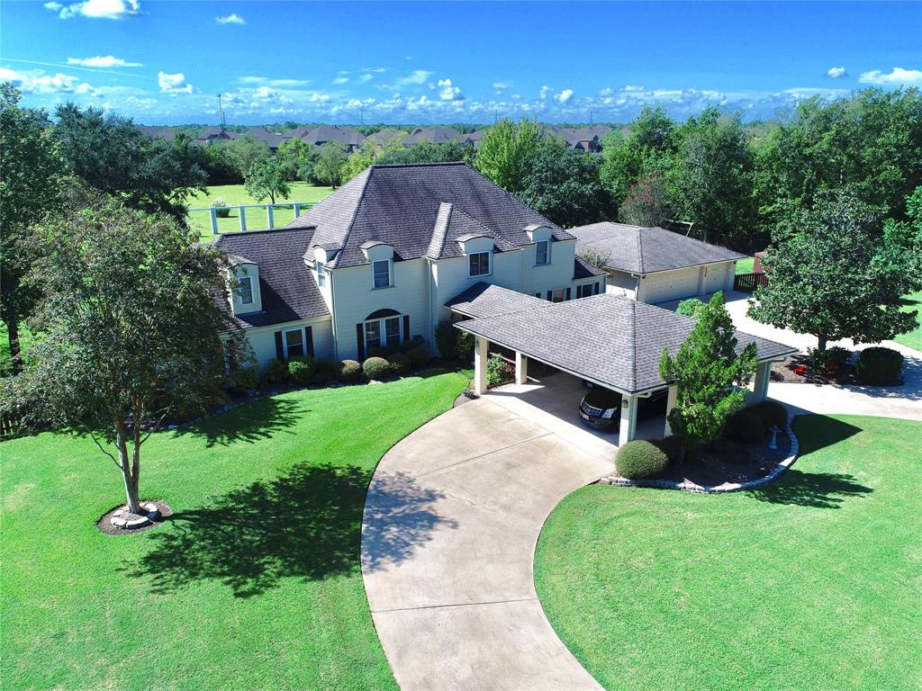 Experience country living right near the big city! This breathtaking home in the City of Pearland is sitting in Pearland ISD on almost 2.5 acres, just short of 4,000sqft, 3.5 bathrooms, 3 car detached garage, 4 bedrooms, formal dining room, reading area, office, media room, huge living room, SUPER CHEAP COUNTY TAXES,  and even on a cul-de-sac. The house has so many rooms and extra space you could convert one of the downstairs rooms into another master bedroom. As if the house isn't grand enough, the beautiful backyard oasis with a built-in pool and multiple seating areas will be the clincher. Bring your horses,  pets,  or ATVS and make the most of all this space.  This home was meant for relaxing when needed and entertaining when you have those fun gatherings. This home is conveniently located just a few short minutes from 288 and the Beltway too. Schedule your showing today and have the best of both worlds! (Address is 5004 McKnight Rd, Pesrland, TX 77584)