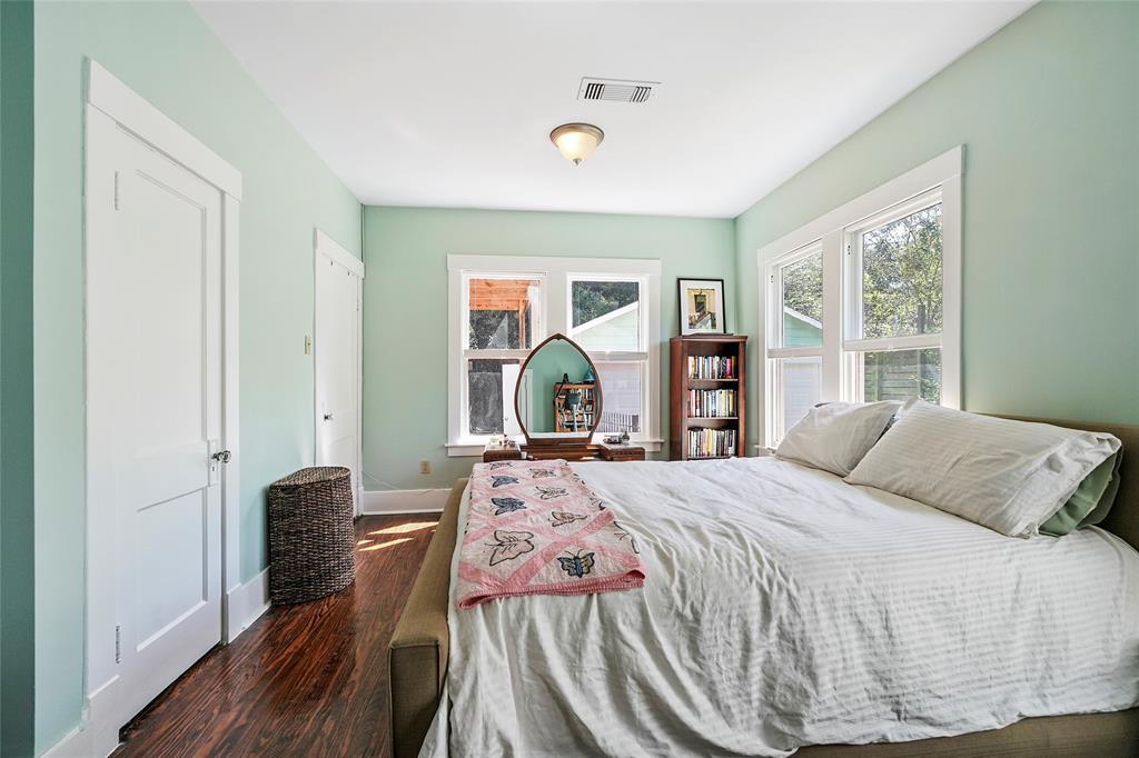 This spacious master bedroom has storage and more.