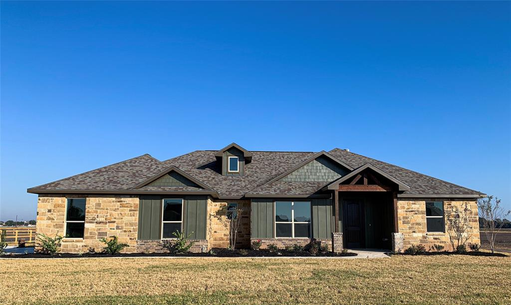 NEWLY COMPLETED! A welcoming, rustic 4 bedroom, 2.5 bath features stained accents in large kitchen, vaulted living room ceiling, and corner fireplace. Charming aesthetics are supplemented with a highly functional, split floorplan. Open concept kitchen/dining/living, walk-in pantry with space for chest freezer, huge master closet, separate sinks/vanities in master bath, closet storage in office, and more!