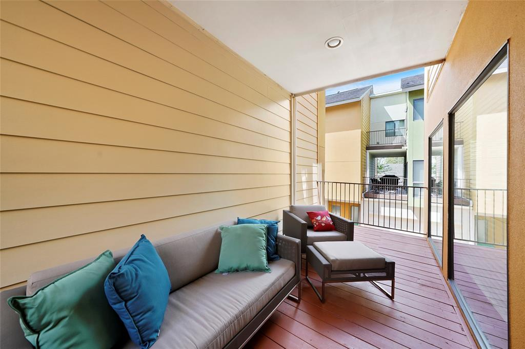 Enjoy your morning coffee on the covered second floor balcony.