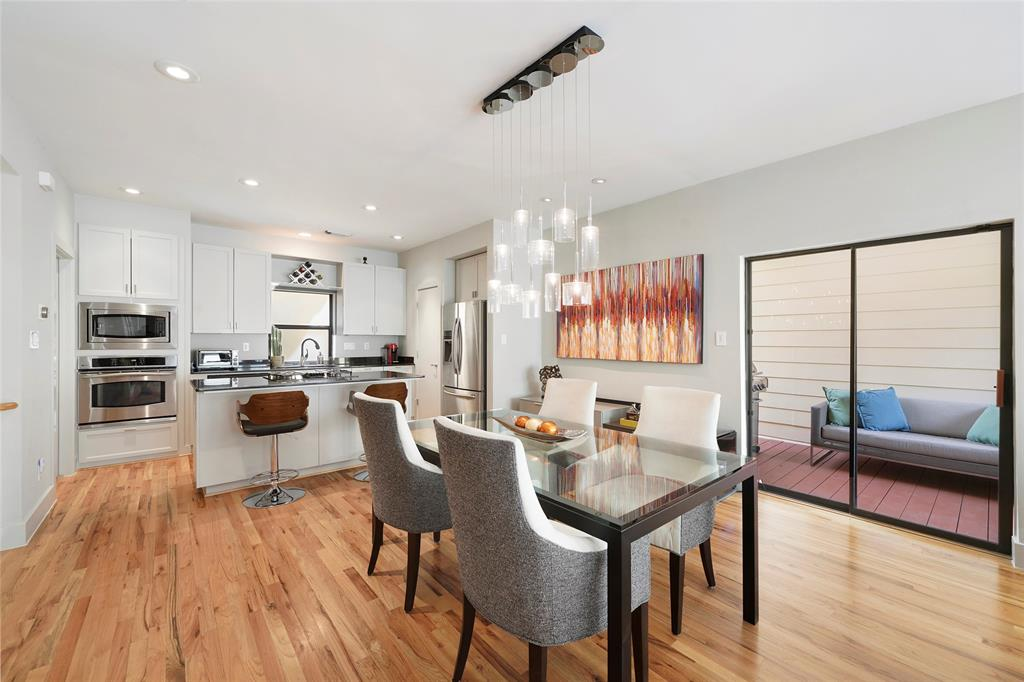 The dining space is open to the kitchen and living room and has easy access to the second floor covered balcony.
