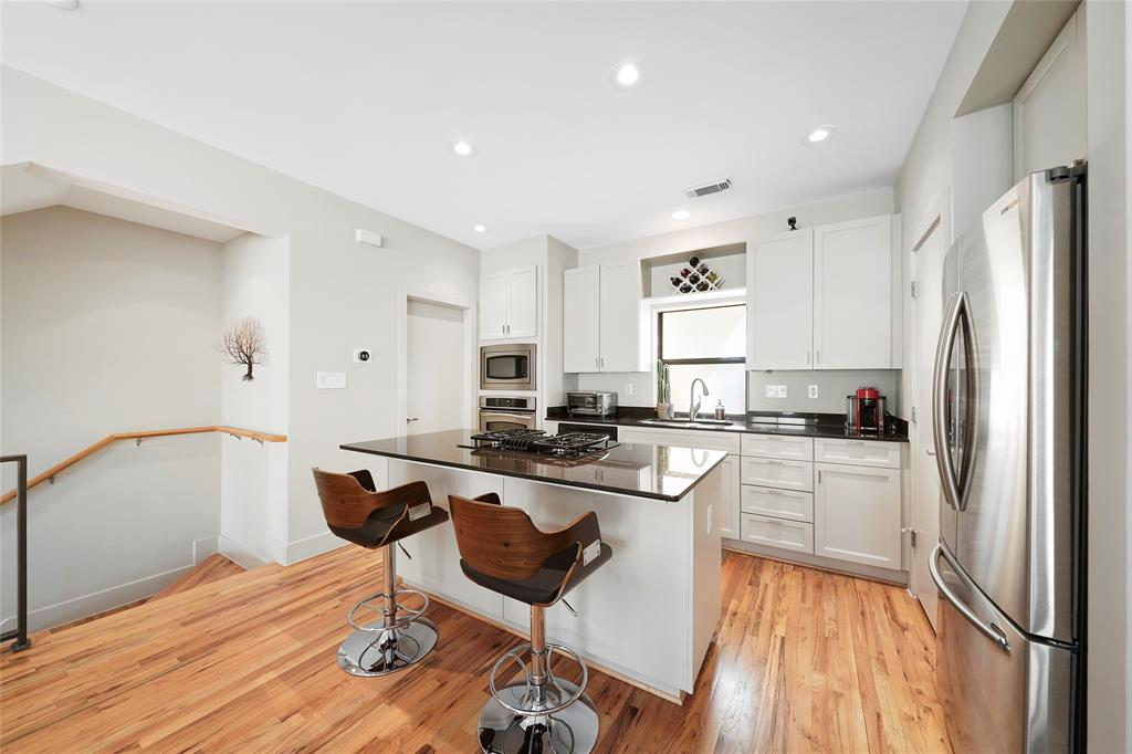 The family chef will love the center-island kitchen with gas cook top.