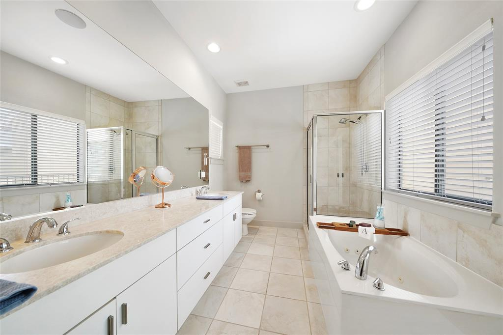 The master bath features dual vanities, jetted tub and separate shower.
