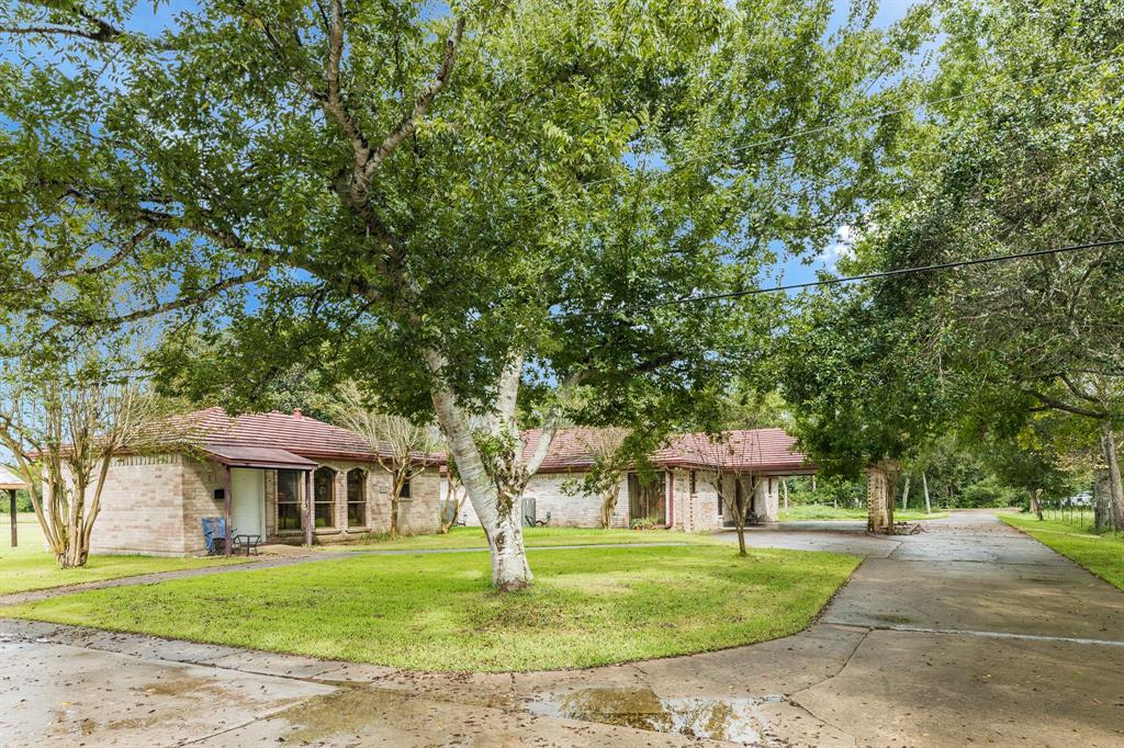 Rare to find such an estate in the middle of new development.  Very private yet so very easy to commute to Houston, Brazosport area, Clear Lake or anywhere via beltway.  Well built home needs some updates but is very custom and could easily be a showplace.  4-2 with huge living area, big kitchen, huge Master with split floor plan. Guest house or mother in law house 680 sq ft, pool, barn, shop, pond and so many extras the list goes on.  Lots of custom wood, great wood burning fireplace and an additional 15 ac available to give an ag exempt ranch of 25 ac.