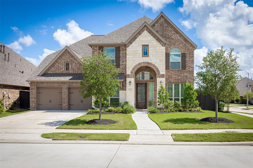 Stunning Two-Story Perry Home in Harvest Green on a Corner Lot Zoned to Ft Bend ISD Schools. Luxurious Open Floor Plan w/ Grand Spiral Staircase, Nice Rotunda, High Ceilings, and Premium Finishes. Amazing Island Kitchen w/ Granite Countertops, Stainless Steel Appliances, Butler's Pantry, and Beautiful Island Perfect for Cooking. Private Master Suite with Double Sinks, Garden Tub, & Separate Glass-Enclosed Shower. Spacious Second Bedroom with Full Bathroom/ Closet. Oversized Game Room and Walk-in closets w/ Ample Storage Space! Extended Covered Patio and Nice Backyard Perfect for Entertaining Guests! Fantastic Location Close to the Harvest Green Rec Center, Farmers Market, & Close to Hwy 99. NEVER FLOODED IN HARVEY! EXCELLENT CONDITION - SCHEDULE A SHOWING TODAY!