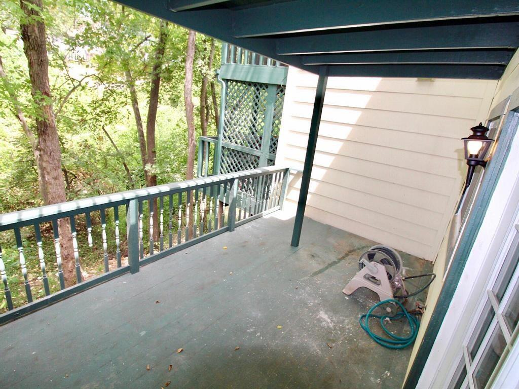 First floor balcony with private wooded view.
