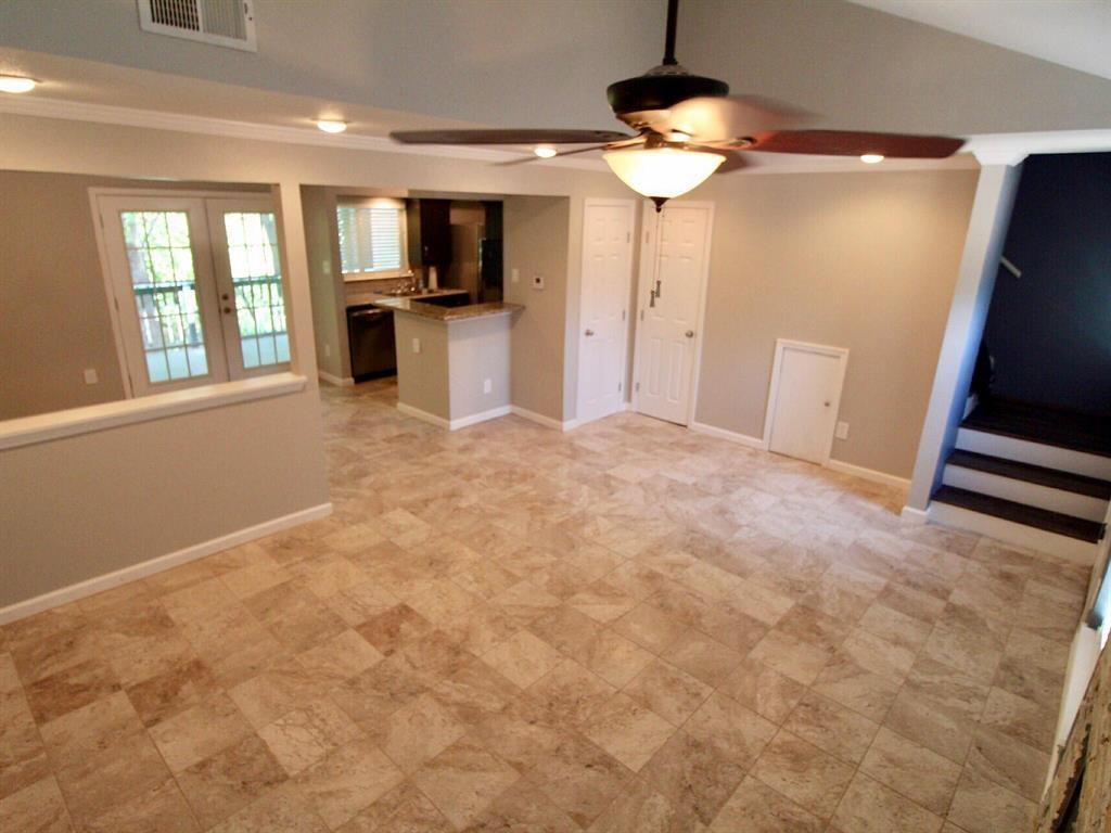 Another view of the living room facing the dining and kitchen areas.