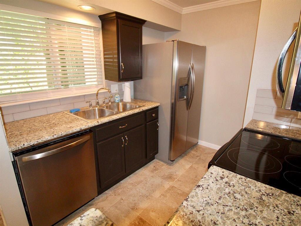 Kitchen with updated stainless steel appliances.