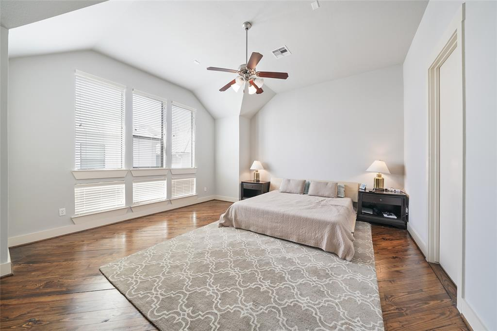 Huge master bedroom includes, 12 foot ceilings, ceiling fan, wood floors, and windows that rise almost floor to ceiling.