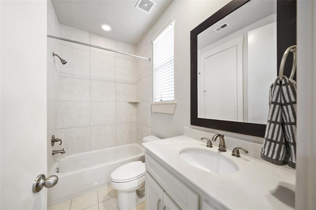 Downstairs bathroom is located right off the downstairs gameroom/living room.