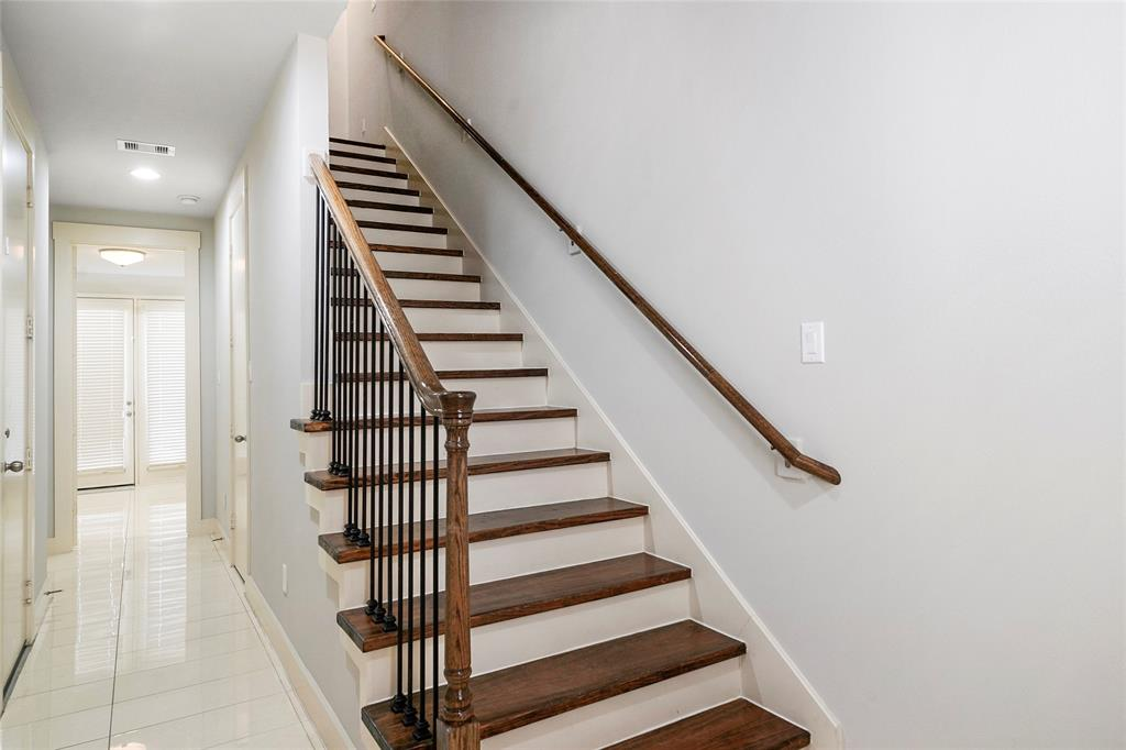 Formal entryway includes marble tiles that extend throughout the 1st floor. Wrought iron spindles adorn the stairs. There are two storage closets in the foyer.