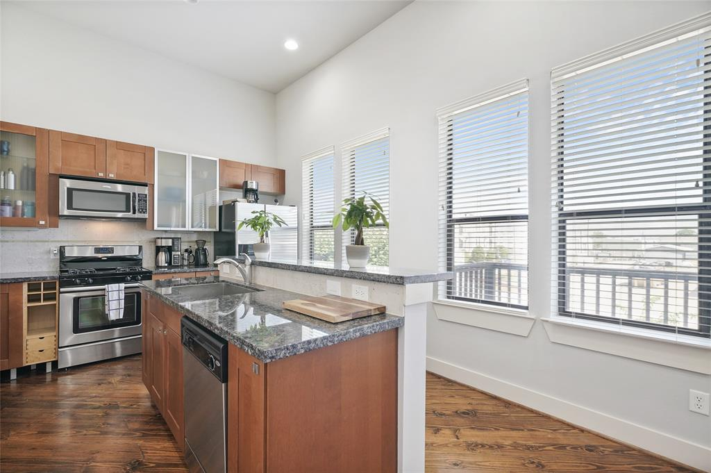 The kitchen offers lots of cabinet space and tons of natural light from the large windows. It also includes soft close cabinets and drawers. Drawers are fully-extendable.