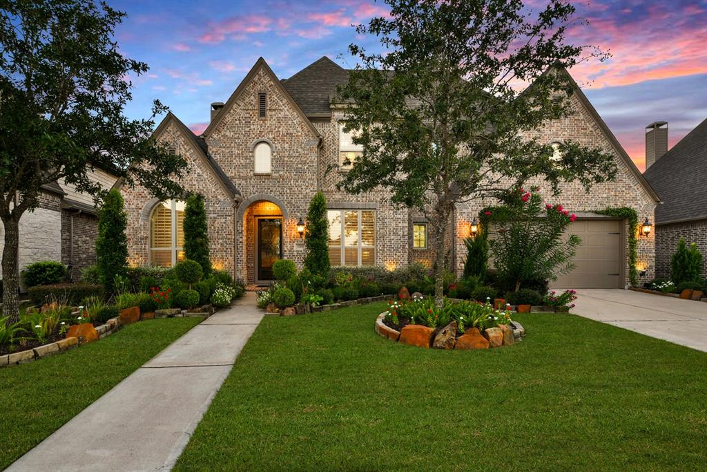 A one-of-one! This completely custom Highland Home rests on a private lot overlooking the water of Aliana, one of Houston's premier master planned communities. Upon entry you'll be greeted by an impressive hardwood staircase flanked by an elegant study & the formal dining with its adjoining butler's pantry. The sprawling floorplan is covered in designer finishes and features two spacious master suites, each with their own spa-like 5-piece bath & separate living spaces. A gourmet island kitchen showcasing custom built cabinetry & a high end appliance package is any chef's dream. Cozy up by the gas log fireplace under the exposed wood beams cathedral ceilings in the great room, or relax on the covered porch or balcony with 180 degrees lake view to enjoy both sunrise & sunset. Upstairs you'll find a kitchenette complete with sink, refrigerator & a dishwasher. Each of the 4 bedrooms have their own private bath & both master suites provide water views. Schedule a private tour today!