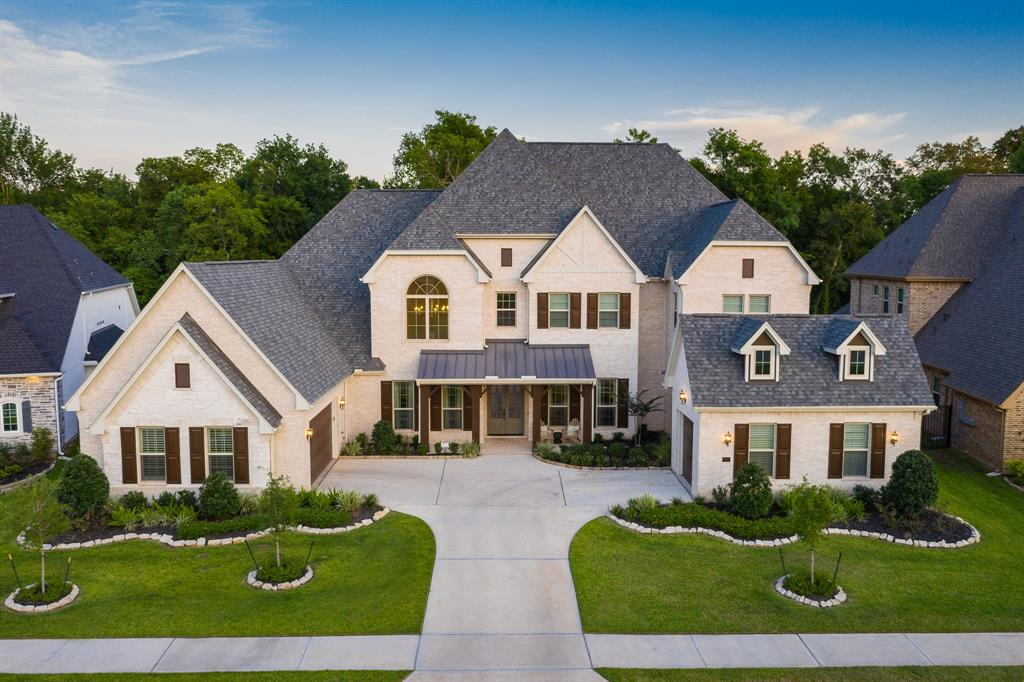 A STUNNING Gracepoint sanctuary, completed May 2018. This BEAUTIFUL home of calm and class is located in the Gated Community of Fox Bend. Whether you're creating a culinary masterpiece in your GOURMET KITCHEN, or entertaining in your spacious 24' ceiling family room, open to the breakfast, kitchen, and dining area, you're sure to create the perfect home for living, and entertaining. In addition to a FUNCTIONAL open layout, and DESIGNER FINISHES, this home has an over-sized laundry center, his study, and her craft room, along with ample storage throughout. Oversized covered patio off family room is great for entertaining, and connects you to a LARGE private backyard on a reserve. So many UNIQUE one of a kind special features, not found in design centers, throughout this GORGEOUS open concept home. Home was specifically designed, and created by a team of interior design professionals. We look forward to showing you this one of a kind beautiful masterpiece.