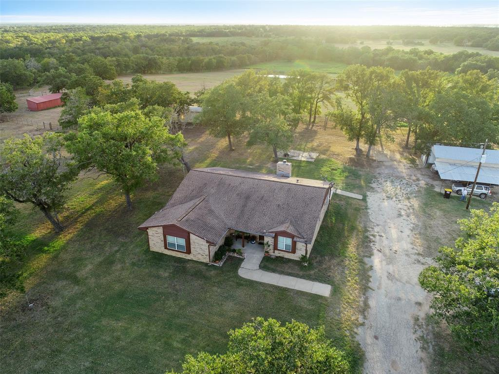 50+ Acre Ranch nestled in the quiet countryside of Paige, TX! This Ranch is a perfect place to raise your livestock with its fully fenced & crossed fenced improved pastures, cattle guard, plus a Tifton-Hay field & two huge ponds surrounded by picturesque views. Property features a 11x40 Open Barn on 3 sides, a 45x30 Barn w/water & electricity to it, a 15x35 Garage, a 14x28 Storage building sheet-rocked w/AC! 3 car carport, large enough to park an RV w/an RV plug. The spacious 1 story, 3 bedroom, 2 bath, well maintained home offers a formal dining room, a breakfast room & a kitchen w/beautiful Corian counters that opens up to the living room + a large utility room! Updates include: New carpet, faucets, toilet & shower glass in master bath, all new doors & paint throughout! Property has water lines to stock ponds, septic system, public water & electricity. Easy commute to Austin & not far from Houston, Giddings, Smithville & Bastrop. Schedule Your Showing today!