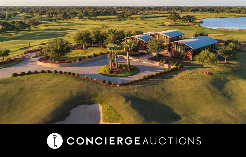 """AUCTION: No Reserve. Open Daily 1-4PM & By Appt. A private hunting lodge, golf resort, or corporate retreat, whatever you can imagine, Wolf Point Golf Club is a beautiful canvas to make it happen. Be part of an exclusive club. With only one previous owner, fewer than 200 people have had the chance to play golf at Wolf Point. Designed by Mike Nuzzo and Don Mahaffey, the 18-hole course, complete with a 12±-acre lake, has been ranked as one of the top 147 courses in the world, and has earned the nickname, """"the St. Andrews of Texas."""" With a 5,000-foot runway and private hangar, Wolf Point has all the necessary components of a world-class getaway for outdoor enthusiasts, including direct access to the gulf with frontage on Carancahua Bay. The luxurious main house has a state-of-the-art commercial-grade kitchen and expansive great room for entertaining guests. Ceiling height windows filter sunlight through the more than 7,000-square-foot estate."""