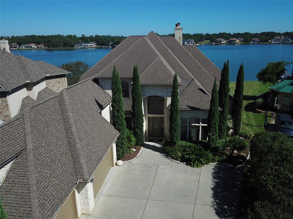 """Waterfront """"Austin Stone"""" home in the gated community of Grand Harbor on Lake Conroe. Panoramic open water views looking north/northeast.  You're on a point with ~150' of bulkhead.  Sun rises/sets side-to-side for lakeside living with sunny mornings & shady afternoons. Over-sized 3-car garage has stairway to a finished, upstairs space. Also accessible from the interior, that space could be separate living quarters or used as a game/media room. Other desirable features include elevator & first-floor and second-floor laundry facilities. Room for a pool in the backyard. Home has natural gas and the cook top and oven (currently electric) are pre-plumbed for gas.  Grand Harbor is located at the beginning of the Walden Peninsula for quick access to Hwy 105 and all the amenities of Montgomery, Conroe or a short drive to the shopping, dining and world-class medical facility amenities of The Woodlands. High & Dry!  Exemplary Montgomery ISD."""