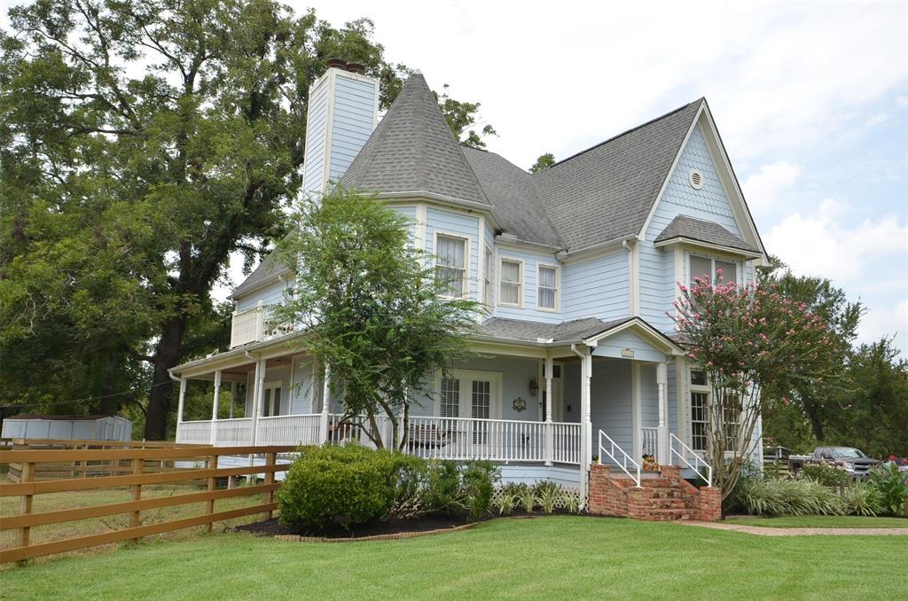 BEAUTIFUL, UNIQUE, 3-STORY LIGHT & BRIGHT VICTORIAN HOME LOCATED AMONG 100 YR OLD PECAN TREES ON 3.4 ACRES, BACKING TO LARGE RANCH! GREAT HORSE PROPERTY W/WOOD & PIPE FENCING, 6 PADDOCKS, 4-STALL STABLE/BARN W/HAY STORAGE, TACK RM & LARGE WORKSHOP! ALL HARDI SIDING, 6 YR OLD ROOF, RECENT CARPET & BEAUTIFUL HARDWOODS IN LIVING AREAS & MASTER BEDROOM! ISLAND COUNTRY KITCHEN! MASTER SUITE HAS SITTING AREA & FIREPLACE, CLAW FOOT TUB & SEPARATE SHOWER, 2 WALK-INS! HUGE GAME ROOM ON THIRD FLOOR! SPACIOUS UTILITY ROOM W/ LOTS OF CABINETS! CEILING FANS THROUGHOUT! PORCHES ALL AROUND & BALCONY UP! ***THIS HOME HAS NOT FLOODED***