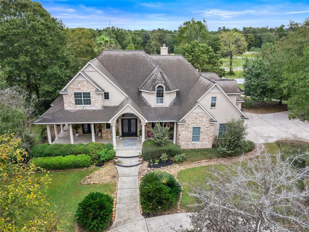 Rare find of 8.3 acres (3 lots) in Montgomery Trace!  On a quiet street with no outlet, you'll feel right at home as you pull in the driveway.  Stunning elevation with a large front patio and circle drive to welcome guests.  At 5955 square feet, this 5/4.5/3 two story home is a blank canvas waiting for someone to make it their own trophy property.  Includes large island kitchen open to the breakfast room and living area with a beautiful stone fireplace. Home has spacious bedrooms, media room, massive laundry room, formal study, formal dining and living areas. Back patio includes an outdoor kitchen area where you can take in the scenery of the pool and pasture. Barn includes 8 horse stalls along with two more bedrooms, a kitchenette, and an additional bathroom.  This home has been reduced well over $250,000 and is priced to sell.  Horses welcome!