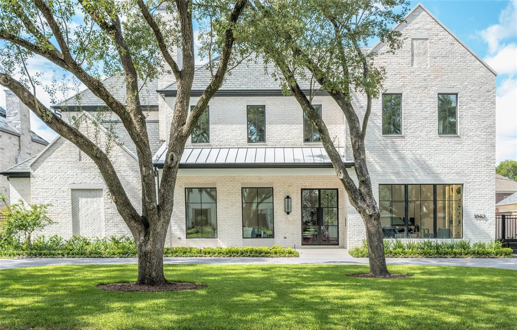 """Quietly elegant, highly-custom home created by J. D. Bartell Design & built by J. A. Taghi Design/ Nick Taghi Construction, in a modern transitional style with antique white brick, stucco, and siding. Open light-filled interior w/12-ft - 24-ft ceilings; European oak floors; 12"""" baseboards; hand-selected, book-matched marble walls & waterfall countertops; Italian porcelain tile floors, wall accents, and backsplashes; high-end art, recessed, & pendant/chandelier lighting. Inviting entry flanked by study, formal living room & dining room; great room w/fireplace open to gathering kitchen; full bar w/temp-controlled wine vault; SubZero, Wolf, Asko appliances; Miele coffee system; powder room w/custom floating vanity; 1st-floor master w/sitting room & bedroom w/double fireplace; sumptuous marble-clad bath w/waterfall sink decks; art-glass & marble shower; auto privacy shade; slipper-foot tub; 2 water closets. En suite bedrooms; game room w/juice bar; 3rd-floor w/full bath. All stop elevator."""