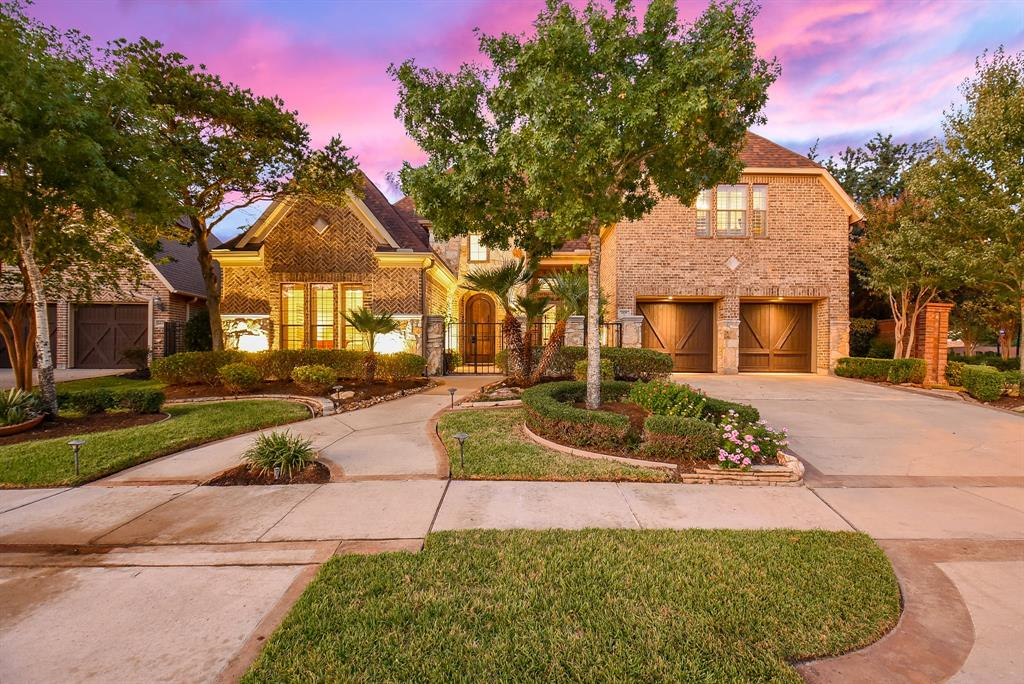 """This one-of-a-kind Darling home, located on a large corner lot in Sugar Land's coveted Telfair community, has nearly $150k of upgrades. It features luxury details such as custom cabinetry throughout, crown molding, and designer lighting, and is an entertainer's dream with its chef's kitchen and open-plan great room. The lush, professionally landscaped, private yard has a covered patio and in-ground pool. The kitchen features a 48"""" 6-burner gas range with griddle and double oven, plus wall oven, warming drawer, built-in fridge, and large island. The main-floor master adjoins a cozy sitting room with fireplace, and has a walk-in dressing room with custom closet cabinetry. The master bath is a true spa retreat with separate shower, jetted tub, and double vanity. The main floor also has a home office, 2 more bedrooms, and an oversize laundry room. Upstairs is a large bonus/game room and a bedroom that makes an ideal home gym. Never flooded, this home is a MUST SEE! Call today for appt."""