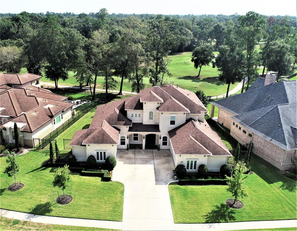 Nestled on a gorgeous golf course setting, this Jamestown Estates home masterfully interlaces modern inspiration & understated elegance. Marked by defined clean, distinctive lines & numerous golf course views, it is anchored by wide planked, white wash hardwood flooring. Its beauty is punctuated by the dramatic entry, a spectacular staircase, soaring ceilings & multi-dimensional picture perfect views of the greenery-draped backdrop of the golf course. A pronounced openness sweeps the downstairs, dictating an open feel concept where each of the rooms are bathed in an abundance of light. A white cast stone fireplace serves as the focal point of the living room that interconnects w/ the gourmet kitchen which features Viking appliances, limestone countertops & weathered marble island w/ pull up seating. The romantic master boasts breathtaking golf course view, private entrance to patio & lavishly appointed bath. Game rm, media rm, outdoor kitchen, 3 car garage, generator.