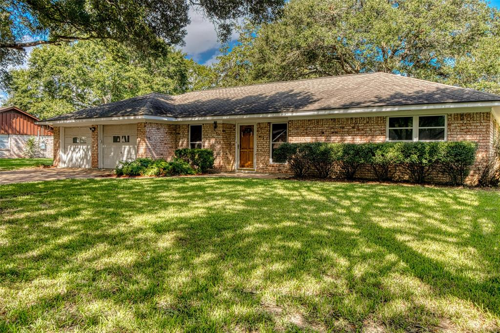 Imagine driving in a Hallmark movie, drive down the beautiful canopy of the tree lined street. This charming neighborhood is proudly presented by all of it owners and true pride of ownership is all around. This loving home has been cared for and kept immaculate. It will be the perfect starter home and/or perfect place to retire. With a spacious family room and connecting dining room/formal living, the space can be configured several ways. The country kitchen is big and spacious with tons of real wood cabinets, double ovens, cooktop, two windows and big eat in breakfast area with bay window. The bedrooms are all spacious with a full bath outside the three bedrooms. The utility room/mud room is adjoined by a 3/4 bath with shower, toilet and sink. The attached garage is oversize and has a full double drive entry. There is a big covered patio off the family room and the massive yard offers a storage building for all your stuff.Come take a country drive to see this small town charming home.