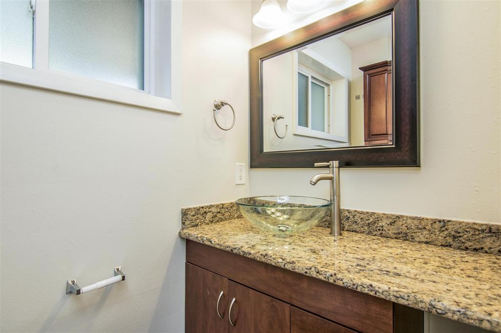 Useful secondary bathroom with tub and tile accents.