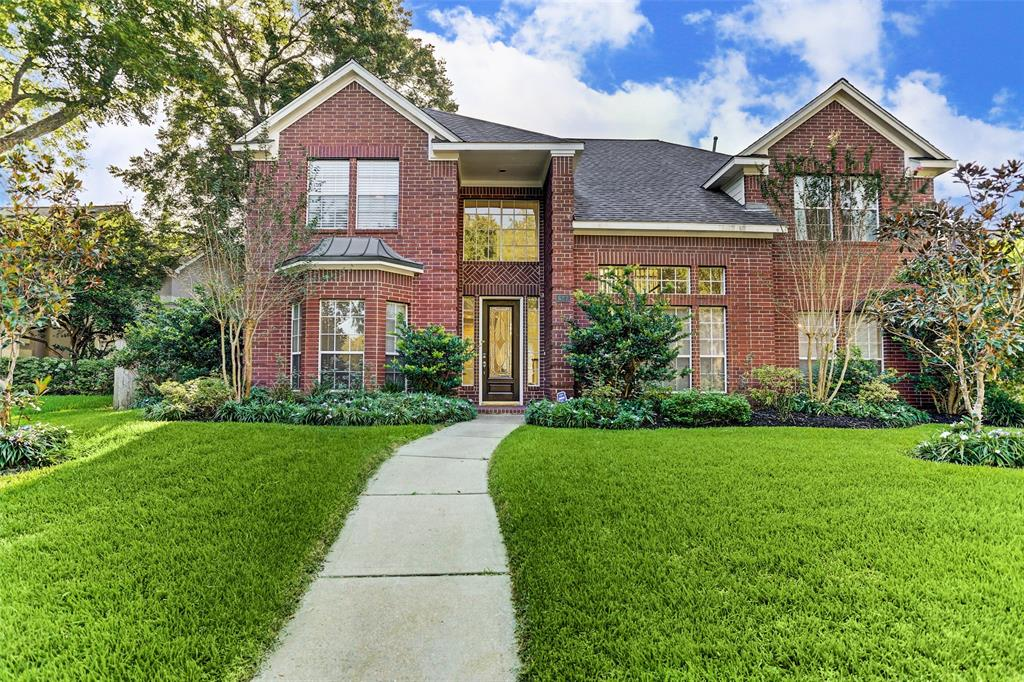 Stunning spacious family home in Sugar Land's New Territory Community. This home features 5 Bedrooms and 4 Full Bathrooms. It features a beautiful island kitchen with granite counters, formal living and dining, large open family room and master downstairs. Upstairs features 3 additional bedrooms 2 bathrooms and a large game room. The home sits on a large lot with mature trees. The backyard features an updated flagstone patio and oversized detached garage. Roof Replaced 2018. Refrigerator Stays. New Territory Community offers amenities such as tennis courts, swimming pools, workout facility and much more. Call to see this fantastic home today!