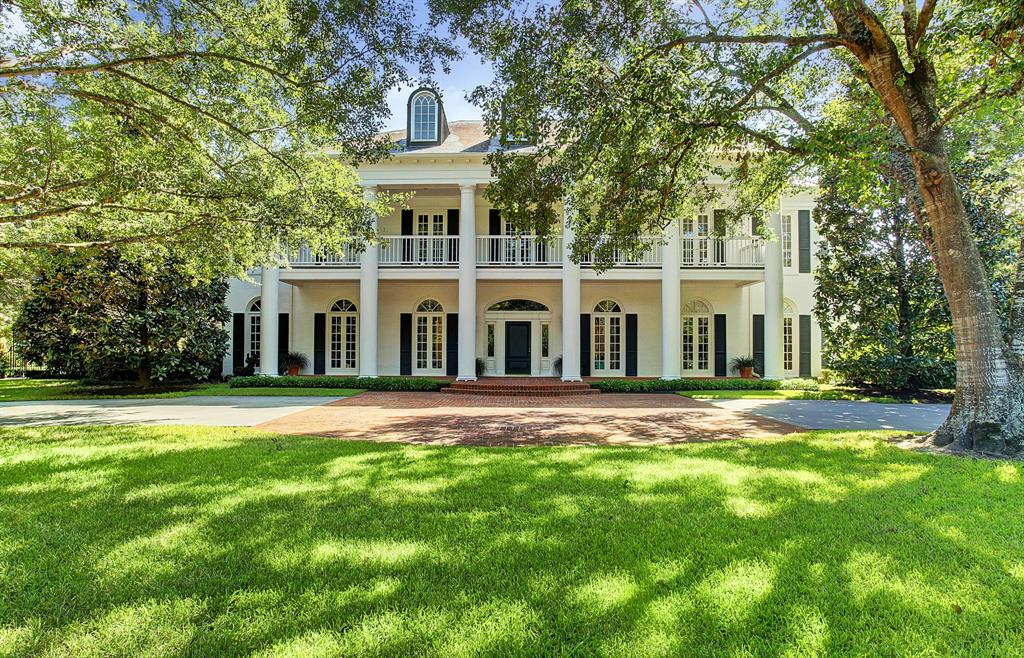This gracious Southern plantation design by Lucian Hood has made heads turn since it was built in 1990.Sitting on a beautiful 3/4 of an acre (HCAD) lot just off River Oaks Blvd., the interior is just as lovely as the exterior premises.Large spacious rooms with high ceilings,exquisite hardwood floors,floor-to-ceiling windows,& impressive moldings.In addition to the formal rooms,there is an inviting paneled library and huge family room.There is a large wet bar with refrigerator,2 wine coolers& ice maker.Outside is a large covered veranda,wonderful heated pool,spa,and fire pit.The exceptionally large Master has a fireplace, his & her baths and closets-his bath with a steam shower.Her closet,bath and dressing area are incorporate almost 900 (approx.) sq.ft.Just off the Master is the 5th bedroom & bath which could be used as a nursery, work-out rm or office.Bedroom #2 could be a 2nd Master or an upstairs family rm,plarm or media rm.All bedrms have ensuite marble baths.All per Seller