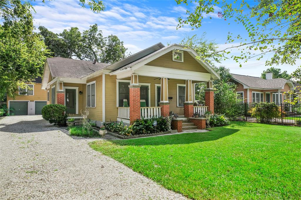 Classic Heights Bungalow on an over-sized lot with a pool and garage apartment.