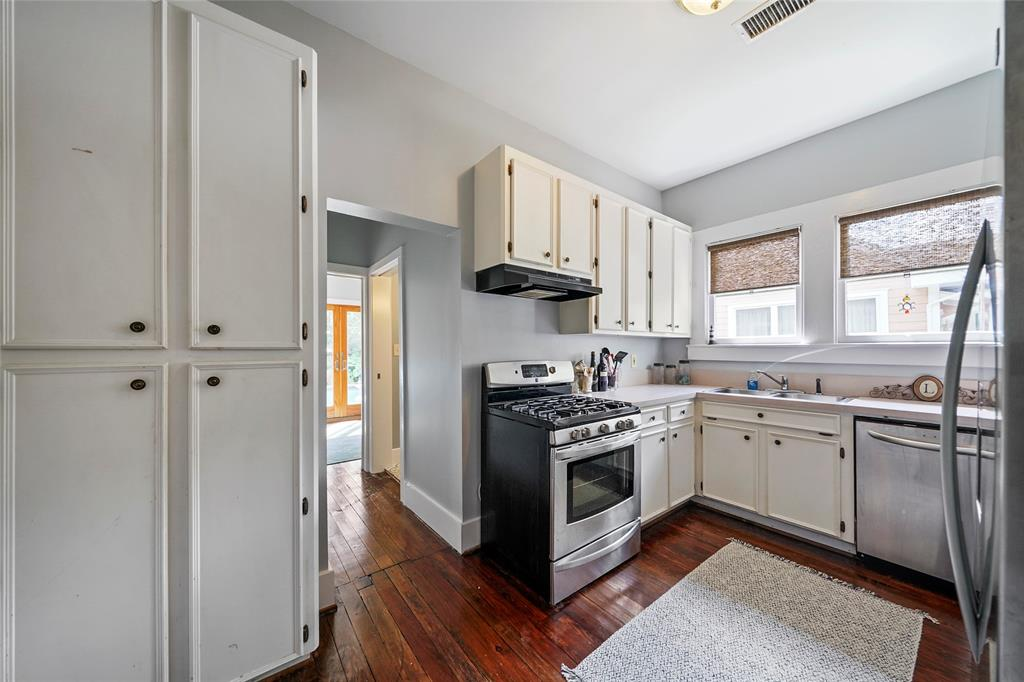 The kitchen features a gas range and stainless steel appliances.