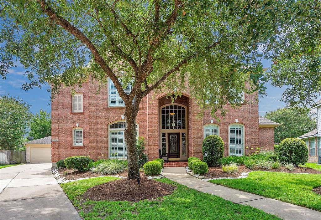 Welcome to 7722 Northwoods, where you will be proud to call this beauty your home sweet home!  This lovely Village home is situated on an over-sized lot in a great location, Greatwood Manor.  Easy access to 59. It boasts a  grand entry with gleaming hardwoods, plantation shutters, crown molding, tastefully remodeled kitchen and master bathroom!  HUGE ISLAND Kitchen includes stainless steel appliances, double ovens, gas cook top, and custom wine shelving. Custom built-ins in family room, all bathrooms have been updated, custom closet in master is a must see along with the master bathroom suite.  You can watch television and have a coffee bar in your own resort-styled master bathroom!  Three car-garage, sprinkler system, lush landscaping, and so much more.  This one is definitely one that you need to see!  Schedule your appointment today!